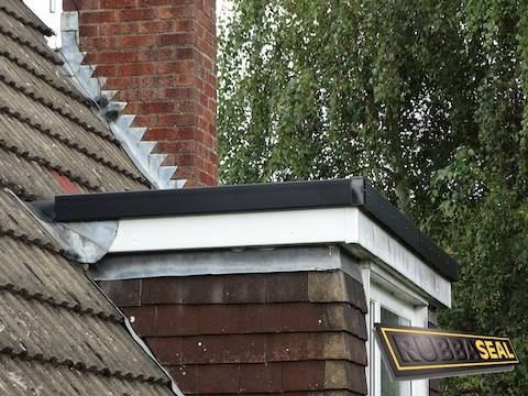 a dormer roof draining to the rear